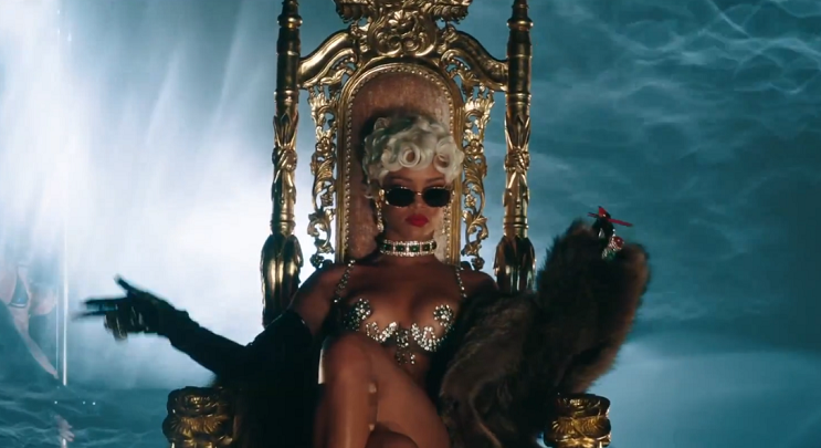 Rihanna posing on her throne in Pour It Up.
