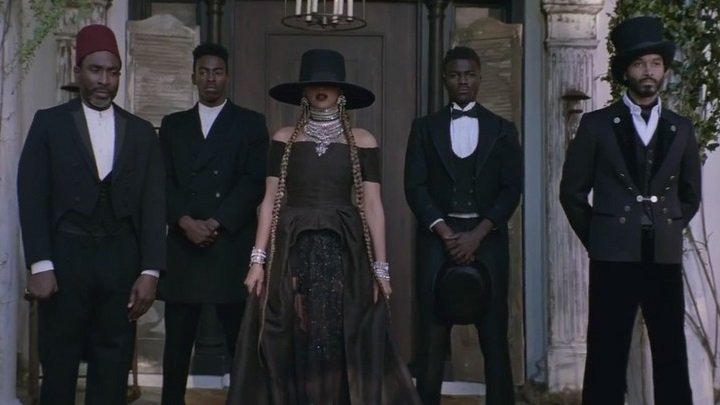 Beyonce stands with four black men in the video for Formation.